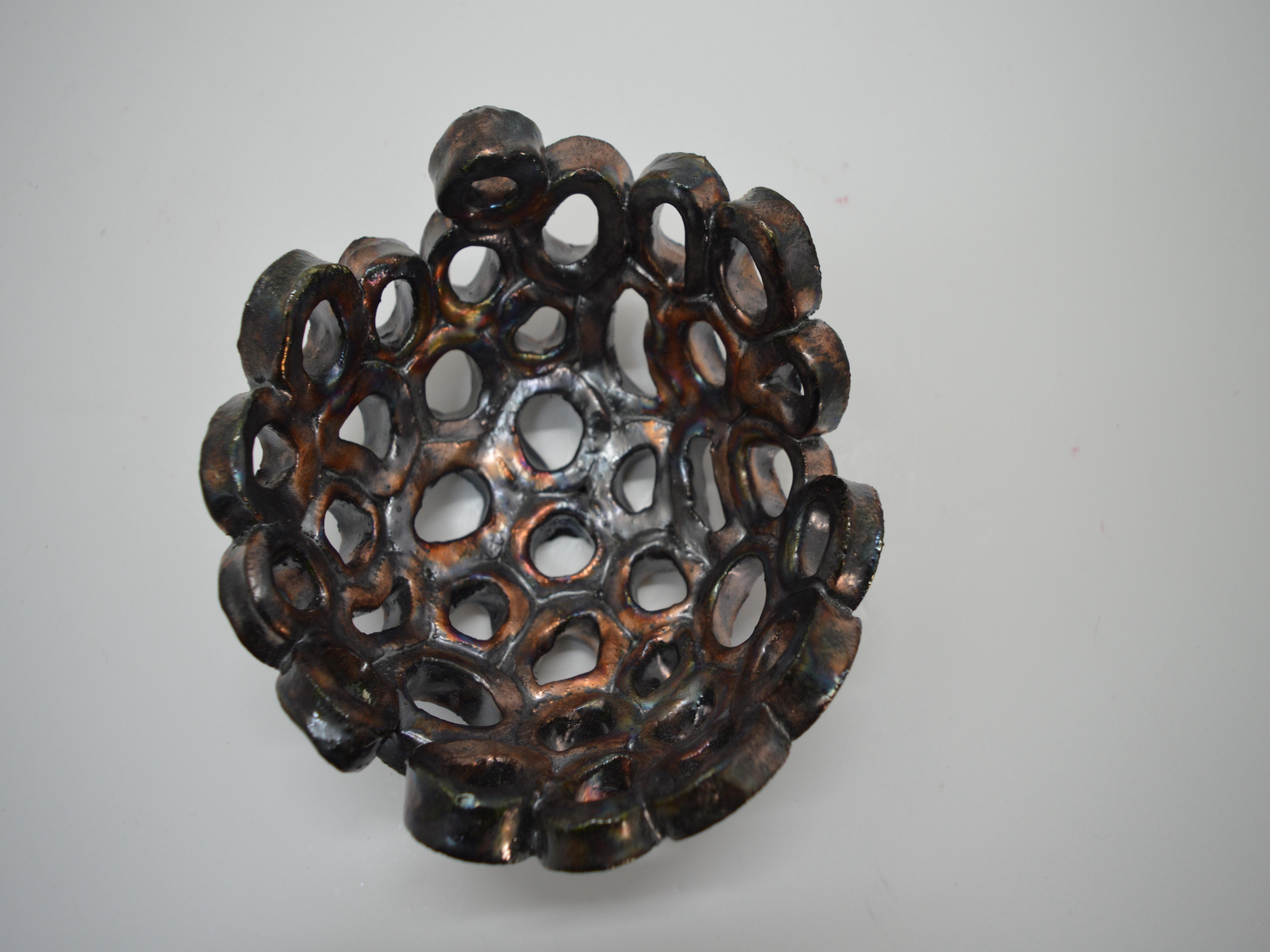 bronzo iridescente microsfere buco